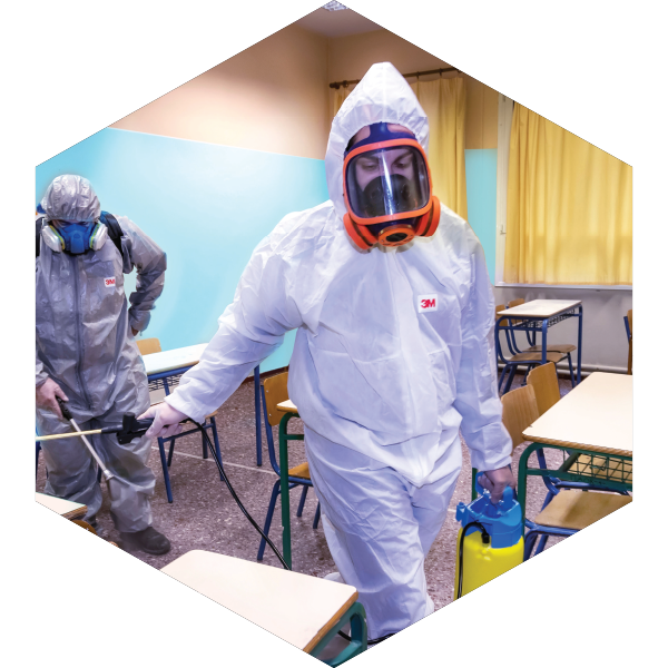 A photo of a two man working on sanitizing a room